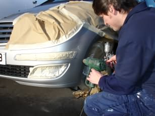 photo of Sprintfinish operative mending a car